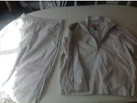 New Unused Izod golf all weather performance enhanced XFG men's size Large two piece suite.