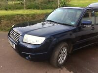 Subaru Forester. Dark blue, v good condition. Recent mot . 2new tires. Well maintained