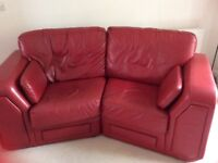 2 red leather sofas.