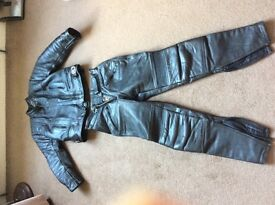 Vintage motorbike leather jacket and trousers.