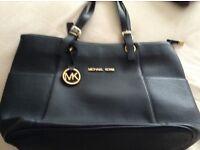 Three brand new handbags