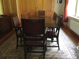 Solid Oak Table, and 8 solid oak chairs! Table extends, must be viewed!