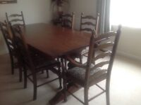Oak dining room table with six chairs