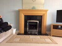 Light oak fire surround with lights Excellent condition. Cost over £300. Sell for £100.