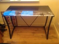 Glass topped desk and leather chair . Good condition