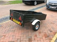 Trailer with rear lights and good tyres.