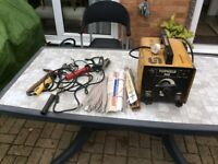 Arc Welder with brazing attachments and 150 various welding sticks.