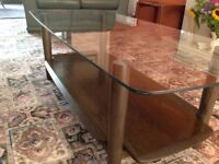 Ercol dark wood coffee table. Glass top. Good condition.