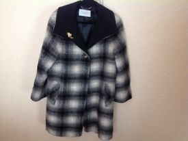 A black and white check ladies three quarter length Windsmoor coat size 12 to 14.