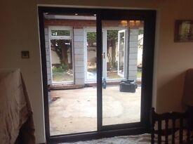 Double glassed UPVC Patio sliding doors 175 x 205 cm - mahogany coloured.