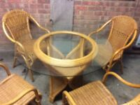 Wicker and glass table with chairs