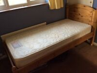 Honey coloured solid pine frame single bed and mattress