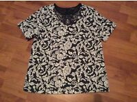 Ladies warehouse black and white top size 10 - has necklace design - never been worn but no tags