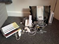 NINTENDO WII WITH 6 GAMES AND ACCESSORIES