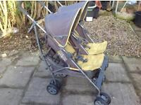 Mamas & Papas double buggy/pushchair with raincover.