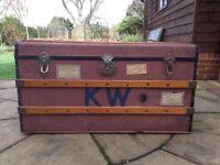 Large old steamer trunk. Original wood banding, handles and interior