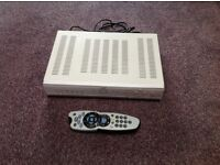 This is a working Sky + box with remote and mains cable.
