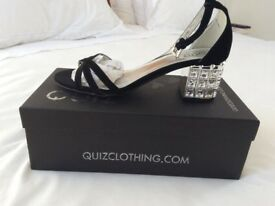 Women's Quiz black ankle strap sandals with sliver lining and sparkle heels never been worn. Size 5