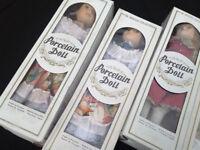Twelve Porcelain Dolls, boxed, All different.