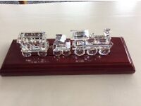 3 piece train set by Swarovski, with track plinth. Retired in excellent condition.