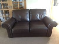 Two seater leather sofa & puffet in chocolate dark brown