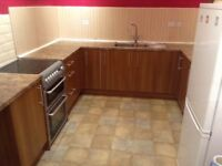 Base kitchen units and work surface for sale. In good condition