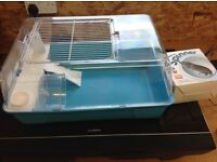 Hamster cage with built in house and spare wheel