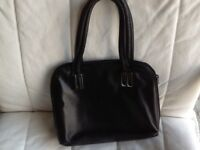John Lewis black leather bag, short handles as new.