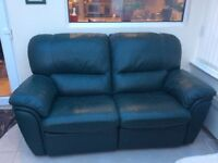 Green leather two seater reclining settee