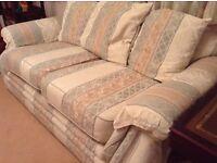 Two seater cushion back sofa