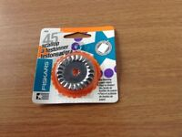 Brand new Fiskars 45mm blade for cutting paper only