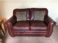 Two two seater chestnut brown leather settees in excellent condition