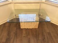 Glass coffee table and stone base in very good condition