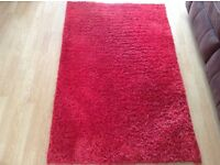 Red shaggy rug excellent condition