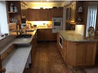 Solid Oak kitchen appliances and granite work tops
