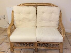 Cane Conservatory settee and pouff.