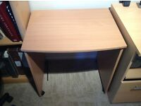 Light wood small computer desk on wheels. 69cm tall, 66cm wide, 51cm deep