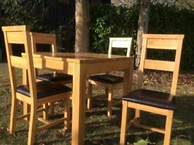 OFFERS ON a beautiful small square solid oak table with four matching chairs