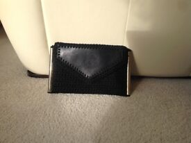 A black clutch bag