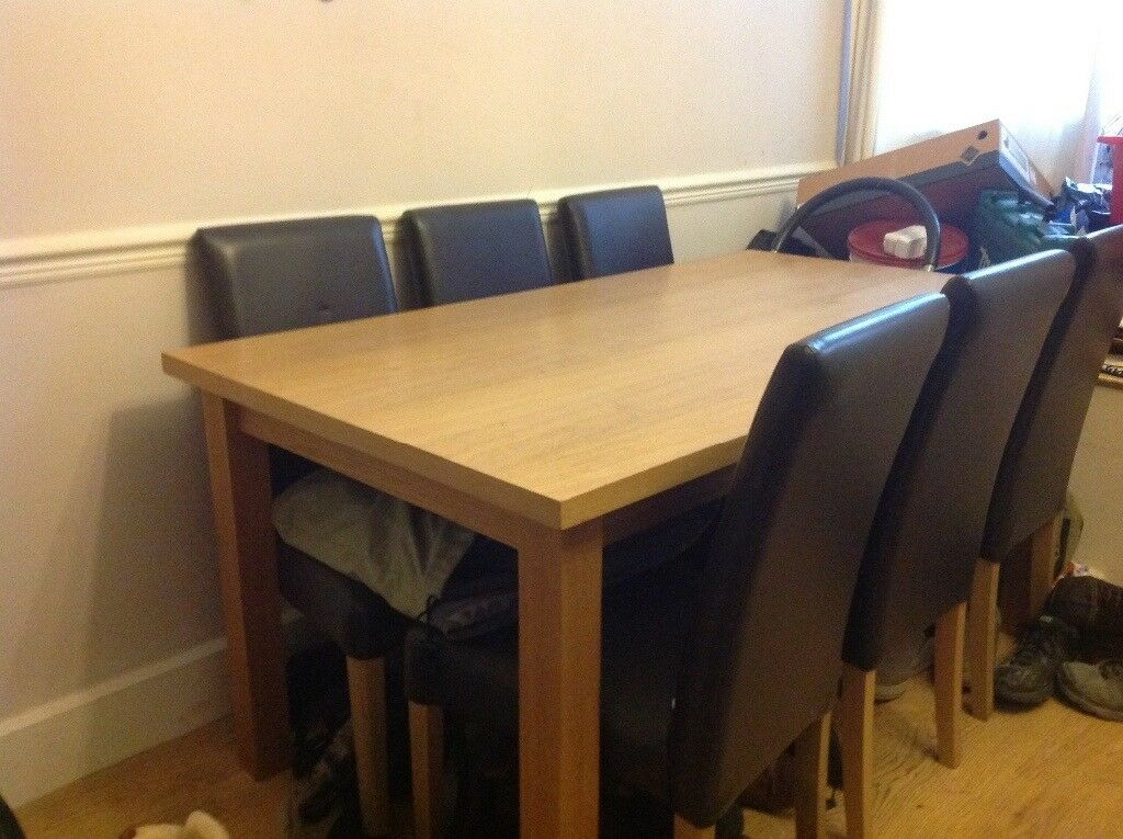 **SOLD**Oak effect dining table and chairs