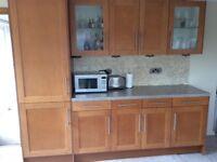 Kitchen units, oven, hob & refrigerator.