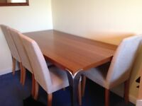Large dining table with 8 chairs