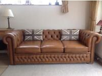 Beautiful tan leather Chesterfield sofa. Can deliver