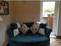 Matching blue DFS Snuggle Chair and Chaise Sofa for sale