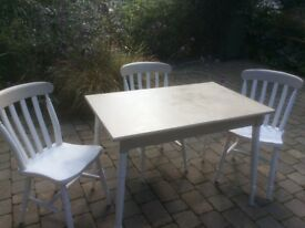 Grey And soft white table and four chairs