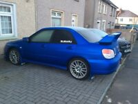 Bright Blue 2008 Suburu Impreza gb270