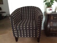 A pair of excellent condition fabric tub chairs on quick sale
