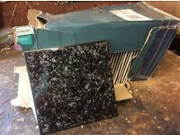 Box of black onyx type tiles