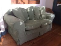 2 seater sofa with 2 extra cushions