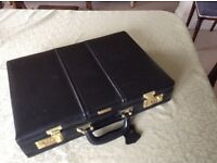 Nearly new black leather briefcase